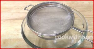 strainer on bowl for dhokla recipe
