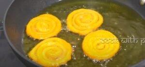 frying jalebi in the hot oil for jalebi recipe